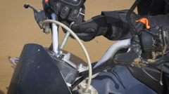 Hands in motorcycle gloves with a key bolt Stock Footage