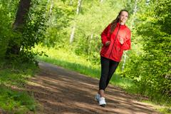 healthy young female athlete running - stock photo