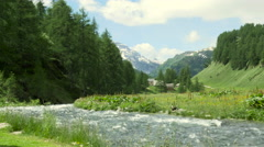 Mountain landscape with clouds and river at Alpe Devero Stock Footage