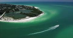 Aerial of Lido Key Island & Speed Boat in Sarasota Florida Stock Footage