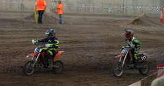 Extreme motocross dirt motorcycle race young boys DCI 4K Stock Footage