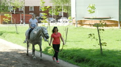A happy young girl riding a white horse in the adventure park, Full HD shot - stock footage