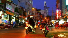 Static view of the busy night street in Ho Chi Minh City Stock Footage