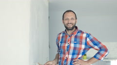 Portrait of young man painting wall at his new home Stock Footage