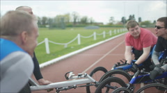 4K Young disabled adults talking to experienced athletes in sports session Stock Footage