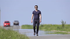 The man walk on the background of a hill. Real time capture. Wide angle Stock Footage