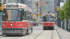 Toronto streetcars on Queens Quay West in Toronto, Canada. Stock Footage