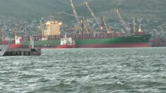 Big Green Red Shipping Boat is Mooring on Seaport - stock footage