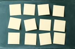 Blank many sticky notes attached to blackboard. Stock Photos