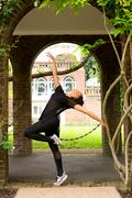 A jazz dancer performing under an archway Stock Photos