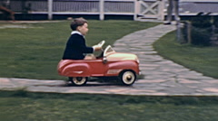 USA 1941: boy driving a toy car Stock Footage