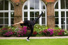 A jazz dancer performing a kick outdoors. Kuvituskuvat
