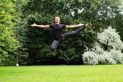 A jazz dancer performing a jump Kuvituskuvat