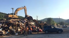 Flood debris being collected at junk yard (HD) - stock footage