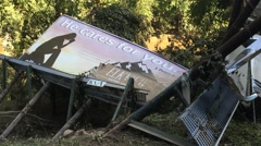 Billboard knocked over by flooding in West Virginia (HD) - stock footage