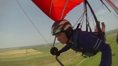 Girl flying on a hang-glider Stock Footage