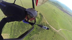 Man flying a hang glider Stock Footage