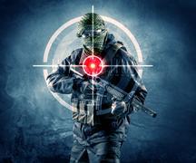 Masked terrorist man with gun and laser target on his body Kuvituskuvat