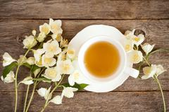 Top view of teacup and blooming flowers Stock Photos