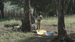 Baby Child waving in poverty Africa GRADED Stock Footage
