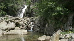 River and waterfall with rocks in mountain ambient at Piedicavallo - stock footage