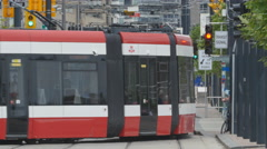 Old streetcar with new streetcar coming into frame. Toronto, Canada. Stock Footage