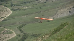 Hang glider flying in the background of grape fields Stock Footage