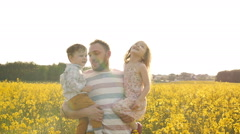 Father holds on hands his son and daughter Slow mo Stock Footage