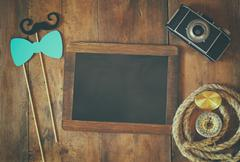 top view of blank blackboard and man's vintage accessories - stock photo