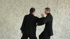 Training in the hall. Two men practicing the elements of tai chi Stock Footage