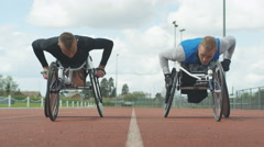 4K Professional disabled athletes training together at race track.  Stock Footage