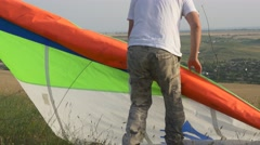 The pilot of hang glider preparing to fly Stock Footage