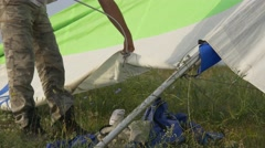 Hang glider pilot puts battens in the sail Stock Footage