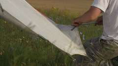 Assembling hang glider continues Stock Footage