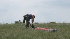 Woman preparing to assemble a hangglider Stock Footage