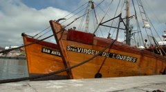 Boats on water moored to the dock Stock Footage