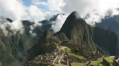 Slow zoom in of machu picchu on a misty morning Stock Footage