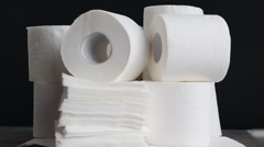 White kitchen paper towel, toilet paper, paper tissues on a black background Stock Footage
