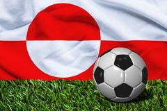 Soccer Ball on Grass with Greenland Flag Background, 3D Rendering - stock illustration