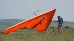 Red training hang glider Stock Footage