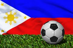 Soccer Ball on Grass with Philippines Flag Background, 3D Rendering - stock illustration