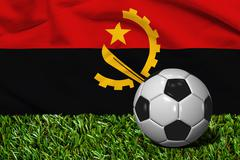 Soccer Ball on Grass with Republic of Angola Flag Background, 3D Rendering Stock Illustration