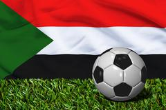 Soccer Ball on Grass with Sudan Flag Background, 3D Rendering Stock Illustration