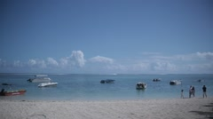 Slow pan right of sunny beach in Mauritius - stock footage