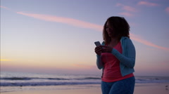Voluptuous Ethnic African American female doing fitness by the ocean to music Stock Footage