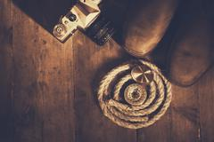 top view of compass, rope, hiking boots and old camera - stock photo