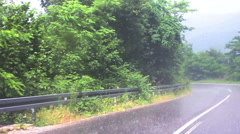 Wet rural road with rain Stock Footage