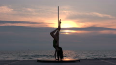 Fit girl poledancer performs fitness pole dance on the portable dancing stage Stock Footage