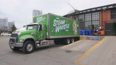 Green beer delivery truck outside Steamwhistle brewery in Toronto, Canada. Stock Footage