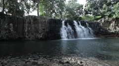 Wide Slow pan right of waterfall in Mauritius Stock Footage